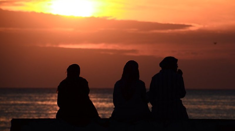 arab muslim women red sea sunset