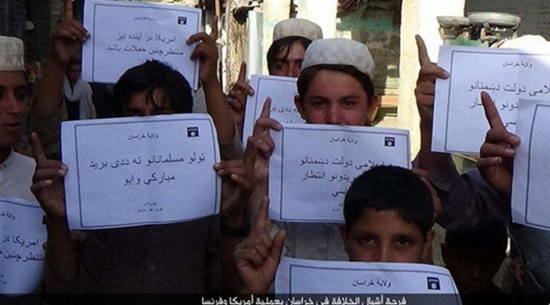 """IS social media distributed photos of children holding placards in Islamic State territories offering """"congratulations"""" on American deaths, apparently in reference to a Florida shooting, on June 12, 2016. In May 2019, IS is increasing attacks and social media posts."""