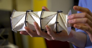 nspired by the paper folding art of origami, a University of Washington team created a paper model of a metamaterial that uses 'folding creases' to soften impact forces and instead promote forces that relax stresses in the chain. Credit Kiyomi Taguchi/University of Washington