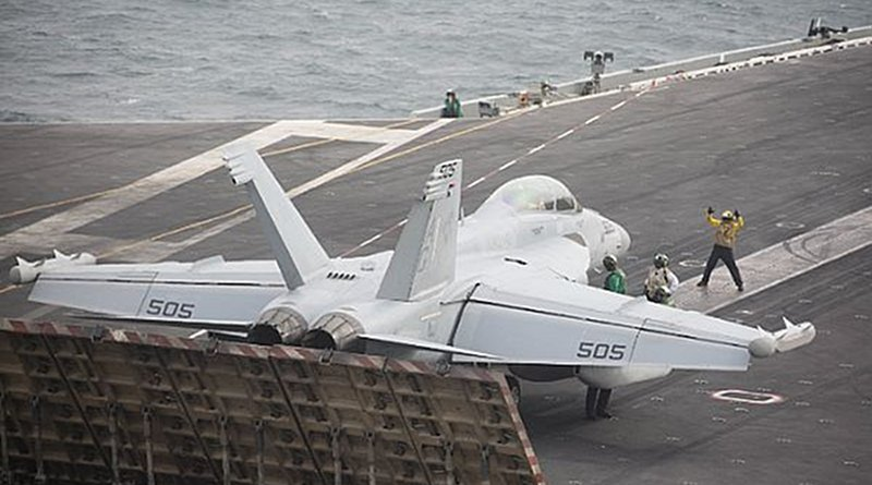 "An E/A-18 Growler from the ""Patriots"" of Electronic Attack Squadron (VAQ) 140 readies to launch from the flight deck of the Nimitz-class aircraft carrier USS Abraham Lincoln (CVN 72), June 16, 2019, in the Arabian Sea. The Abraham Lincoln Carrier Strike Group is deployed to the U.S. 5th Fleet area of operations in support of naval operations to ensure maritime stability and security in the Central Region, connecting the Mediterranean and the Pacific through the western Indian Ocean and three strategic choke points. With Abraham Lincoln as the flagship, deployed strike group assets include staffs, ships and aircraft of Carrier Strike Group (CSG) 12, Destroyer Squadron (DESRON) 2, the guided-missile cruiser USS Leyte Gulf (CG 55) and Carrier Air Wing (CVW) 7. (U.S. Navy photo by Mass Communication Specialist Seaman Apprentice Stephanie Contreras/Released)"