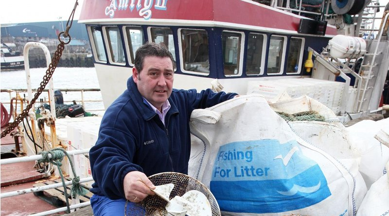 Amity skipper Jimmy Buchan with some of the litter caught by his vessel. Credit Fishing for Litter