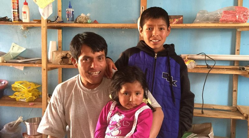 A village official and his children in Copa, Peru, a community that's adapting to changing water levels due to retreating glaciers. Credit Ben Orlove