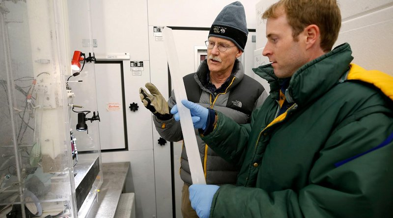 Joe McConnell, Ph.D, the study's lead author, and Nathan Chellman, a doctoral student at DRI and coauthor on the study, examine an ice core in DRI's Ultra-Trace Ice Core Chemistry Laboratory in Reno, Nevada. Credit DRI