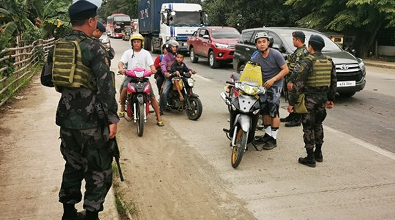 Philippine soldiers conduct checks of motorists in southern Zamboanga province following the arrests of two suspected Pakistani militants, July 12, 2019. Photo Credit: Mark Navales/BenarNews