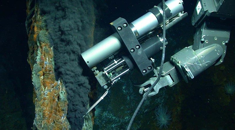 The manipulator arm of the remotely operated vehicle Jason samples a stream of fluid from a hydrothermal vent. The fluid contains gases that are in liquid form because of the high pressure of the deep ocean. CREDIT Photo by Chris German/WHOI/NSF, NASA/ROV Jason 2012, © Woods Hole Oceanographic Institution