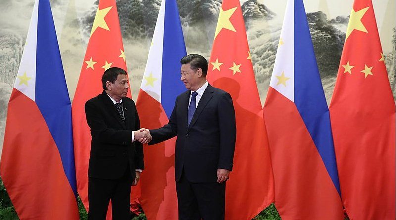 President Rodrigo Duterte and President Xi Jinping shake hands prior to their bilateral meetings at the Great Hall of the People in Beijing. Photo Credit: King Rodriguez of Philippine Presidential Department, Wikimedia Commons
