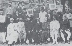 The  first Baha'i National Convention, held on the lawns of Bombay  University's Fort campus, in 1920. From left, the multi-lingual Siyyid  Mustafa Rumi (fifth), who accompanied Baha'i teacher Jamal Effendi on  his tours; Narayan Rao Shethji Vakil (eighth), and just behind him,  Pritam Singh, the first Sikh to become a Baha'i.