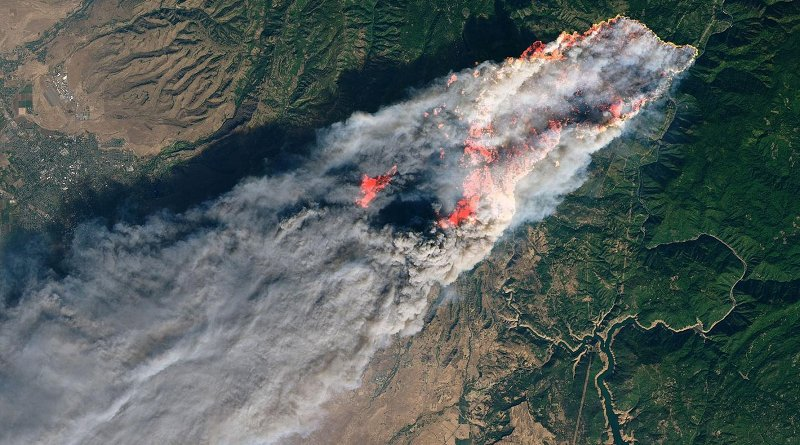 On the morning of Nov. 8, 2018, the Camp Fire erupted 90 miles north of Sacramento, California. By evening, the fast-moving fire had charred around 18,000 acres and remained zero percent contained. Credit NASA