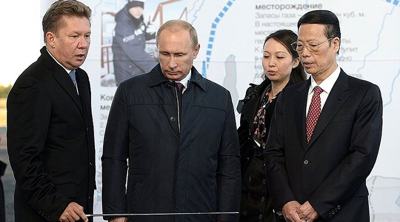 Russian President Vladimir Putin with Chairman of Gazprom's Management Committee Alexei Miller (left) and Vice Premier of China Zhang Gaoli before the ceremony to mark the joining of the first section of the Power of Siberia mainline gas pipeline. Photo Credit: Kremlin.ru