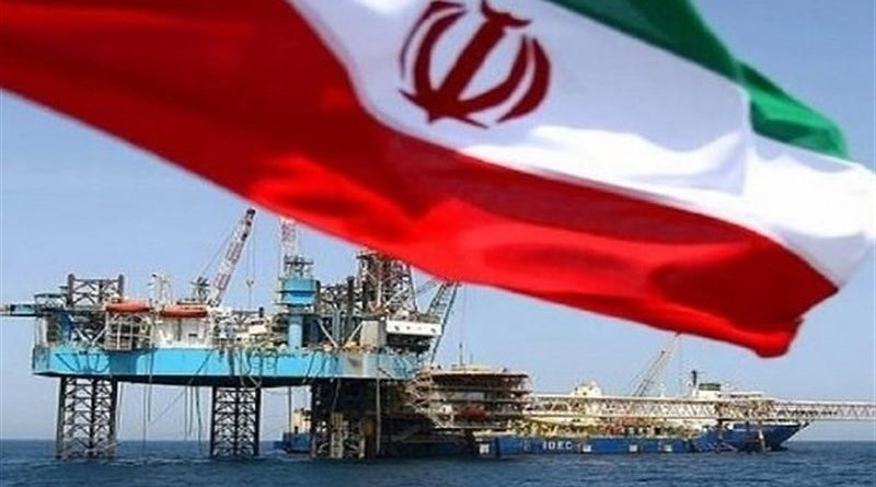 Iran flag and oil platform. Photo Credit: Tasnim News Agency