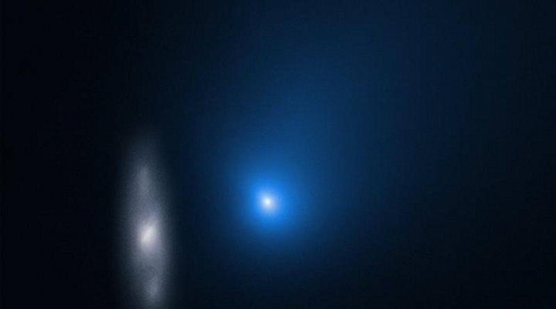 Comet 2I/Borisov is only the second interstellar object known to have passed through our Solar System. In this image taken by the NASA/ESA Hubble Space Telescope, the comet appears in front of a distant background spiral galaxy. CREDIT NASA, ESA, and D. Jewitt (UCLA)