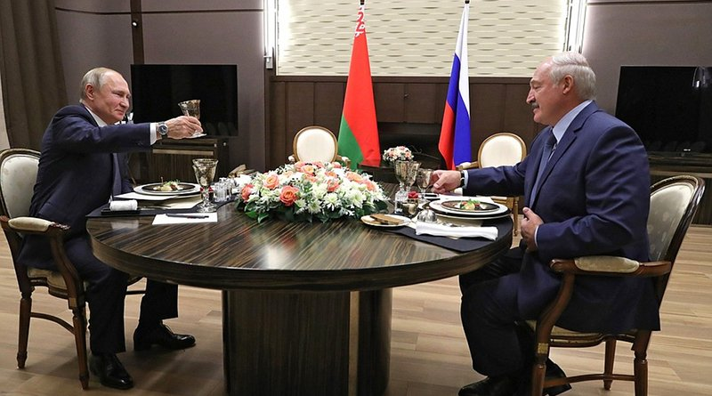 Russia's President Vladimir Putin with President of Belarus Alexander Lukashenko during a working dinner. Photo Credit: Kremlin.ru
