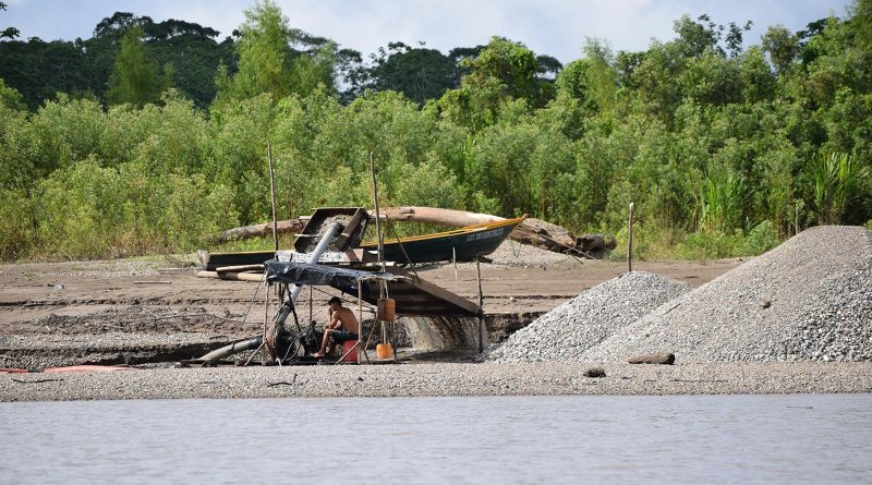 Small-scale, artisanal mining operations such as the one shown here causes deforestation, which in turn leads to erosion that exasperates the release of mercury into the local watershed. CREDIT Axel Berky, Duke University