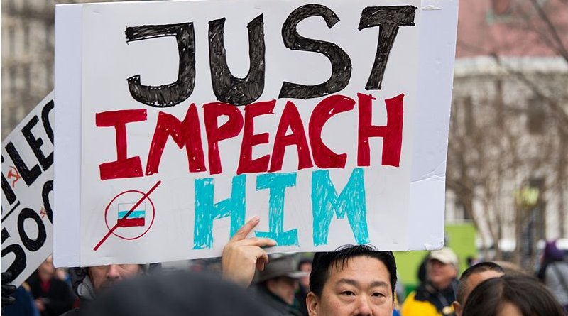 Protesters calling for impeachment on the day of Trump's inauguration. Photo Credit: Mark Dixon, Wikipedia Commons
