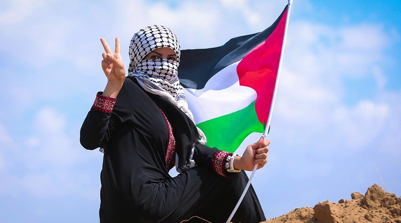 palestine woman gaza peace flag