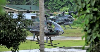 Two attack helicopters from the Philippine military reload missiles as their crews prepare to resume an assault on Abu Sayyaf militant positions Jolo island, an island in the southern Philippines, in April 2019. [Mark Navales/BenarNews]