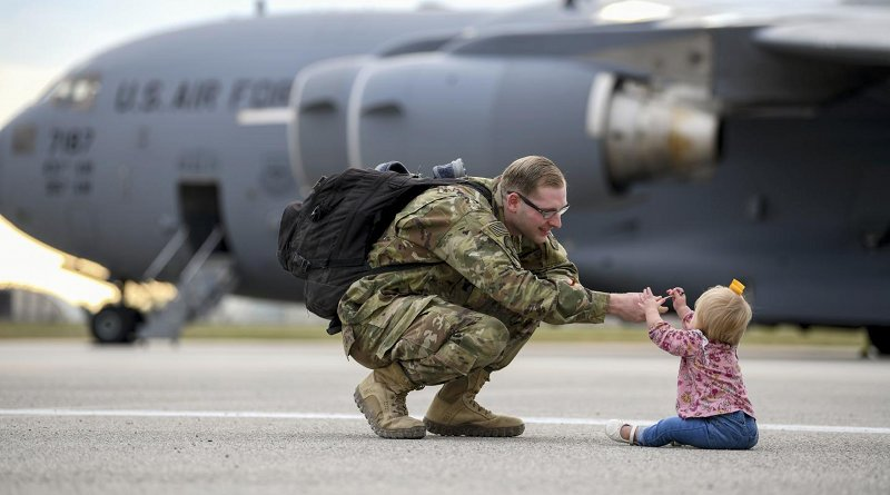 A US airman reunites with his daughter following a deployment. Photo Credit: USAF Airman 1st Class Ericka Woolever