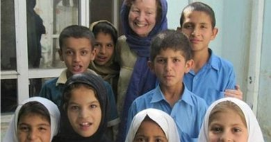Kathy Kelly with children in Kabul, Afghanistan, May 2016.