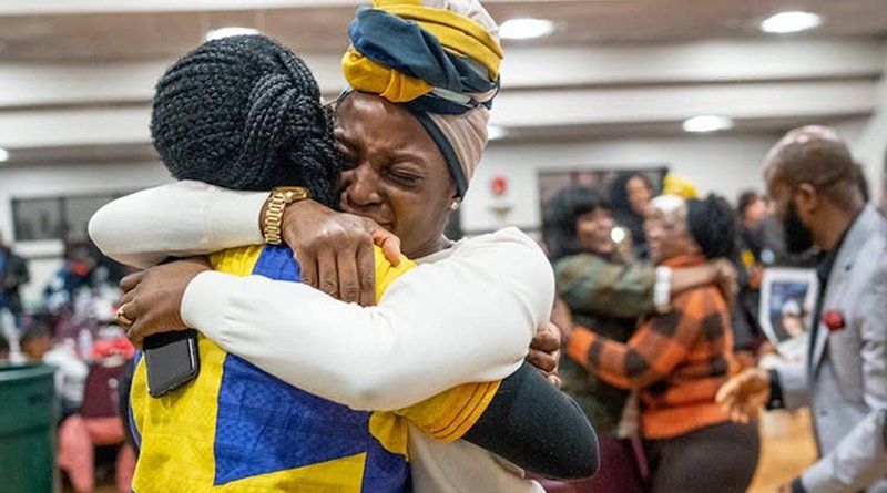 Denise Butler (right) embraced Nelima Sitati Munene on January 4 in Brooklyn Park as they celebrated a new federal law giving Liberians in the U.S. a path to citizenship. Credit: Evan Frost | MPR News