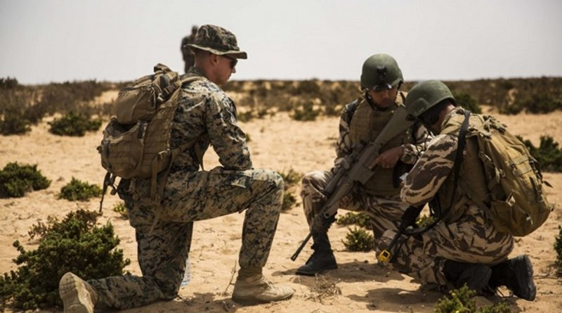 Marine with Special Purpose Marine Air-Ground Task Force–Crisis Response–Africa 19.2, Marine Forces Europe and Africa, evaluates Moroccan soldiers during culminating event at Tifnit, Morocco, July 25, 2019 (U.S. Marine Corps/Margaret Gale)