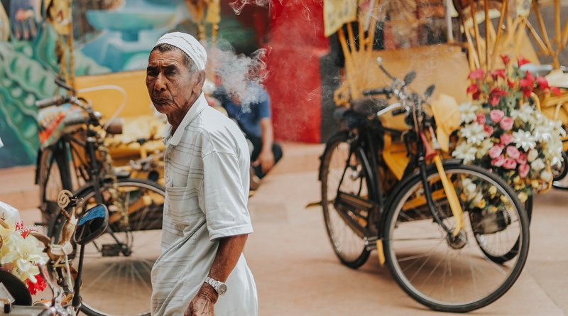Man in Malaysia. Photo by Firdaus Roslan on Unsplash