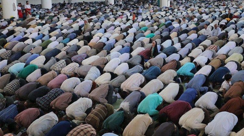 Muslims praying. Photo by Matin Firouzabadi at Unsplash