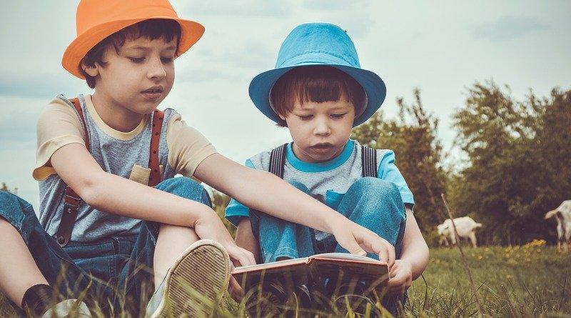 children reading book boys