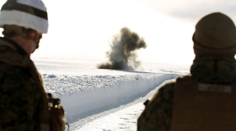 Two service members watch an explosion in Rena, Norway, in advance of Exercise Cold Response 2016, Feb. 22, 2016. Photo Credit: Marine Corps Lance Cpl. Brianna Gaudi