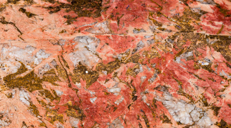 Bastnaesite (the reddish parts) in Carbonatite. Bastnaesite is an important ore for rare earth elements, one of the mineral commodities identified as most at-risk of supply disruption by the USGS in a new methodology. CREDIT Scott Horvath, USGS