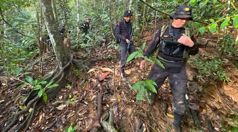 Thai security forces trek through the Tawe mountain range in southern Narathiwat province during pursuit operations against suspected insurgents, Feb. 23, 2020. BenarNews