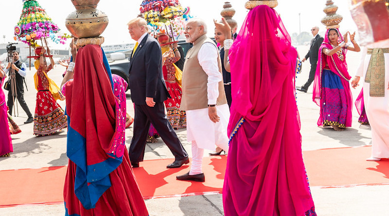 President Donald J. Trump and Indian Prime Minister Narendra Modi walk along a cordon of cultural performers upon President Trump's arrival Monday, Feb. 24, 2020, to Sardar Vallabhbhai Patel International Airport in Ahmedabad, India. (Official White House Photo by Shea Craighead)