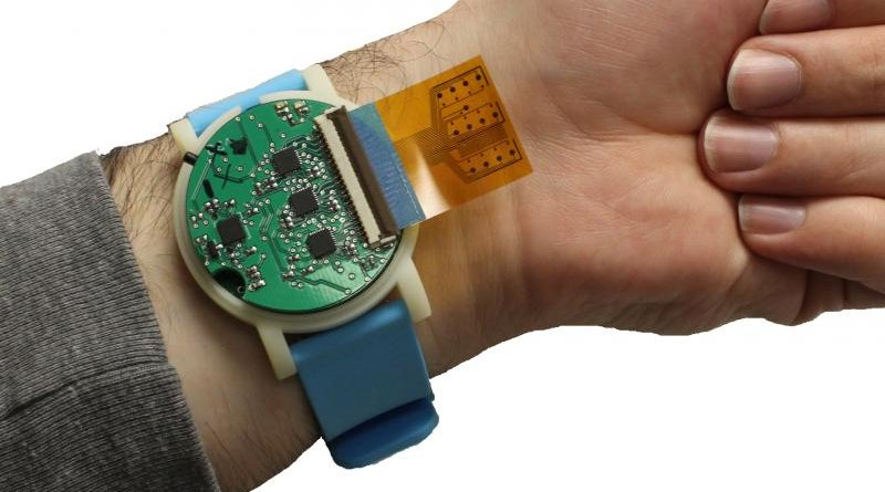 The metabolite monitoring device, shown here, is the size of a wristwatch. The sensor strip, which sticks out in this photo, can be tucked back, lying between the device and the user's skin. The device can be used for everything from detecting dehydration to tracking athletic recovery, with applications ranging from military training to competitive sports. CREDIT Murat Yokus, NC State University