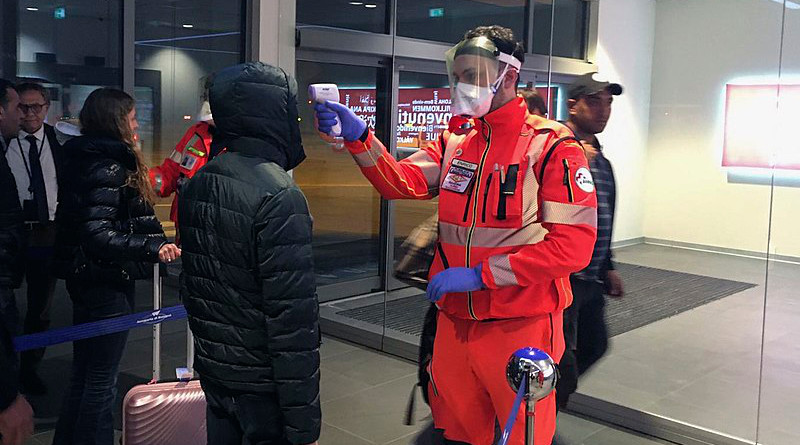 Civil Protection volunteers carrying out health checks at the Guglielmo Marconi Airport in Bologna, Italy. Photo Credit: Dipartimento Protezione Civile, Wikipedia Commons