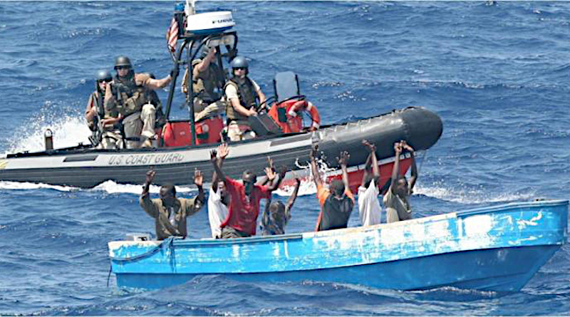 Suspected pirates surrender to a US Coast Guard patrol boat in waters near the Strait of Hormuz. CREDIT U.S. Coast Guard/LCDR Tyson Weinert
