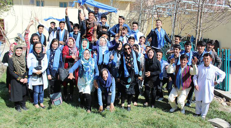 """The Afghan Peace Volunteers wearing blue scarves symbolising their belief that """"all humans live under the same blue sky"""""""
