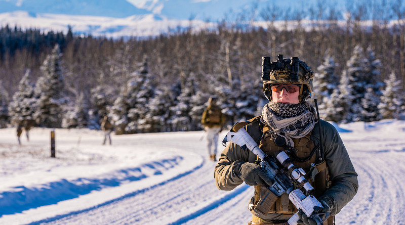 A reconnaissance team member with 1st Reconnaissance Battalion, 1st Marine Division, patrols the area during tactical recovery of personnel training at Fort Greely, Alaska, Feb. 24, 2020. Photo Credit: Marine Corps Sgt. Conner Downey