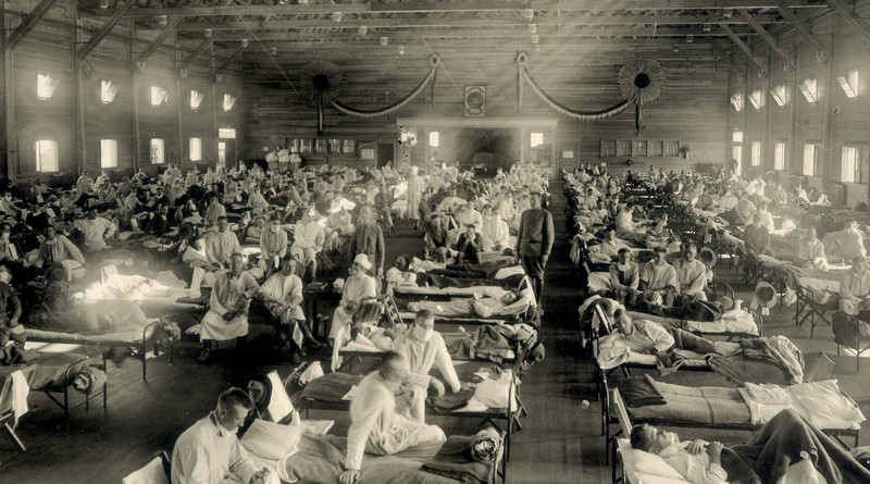 Soldiers from Fort Riley, Kansas, ill with Spanish flu at a hospital ward at Camp Funston. Photo Credit: Otis Historical Archives, National Museum of Health and Medicine, Wikipedia Commons