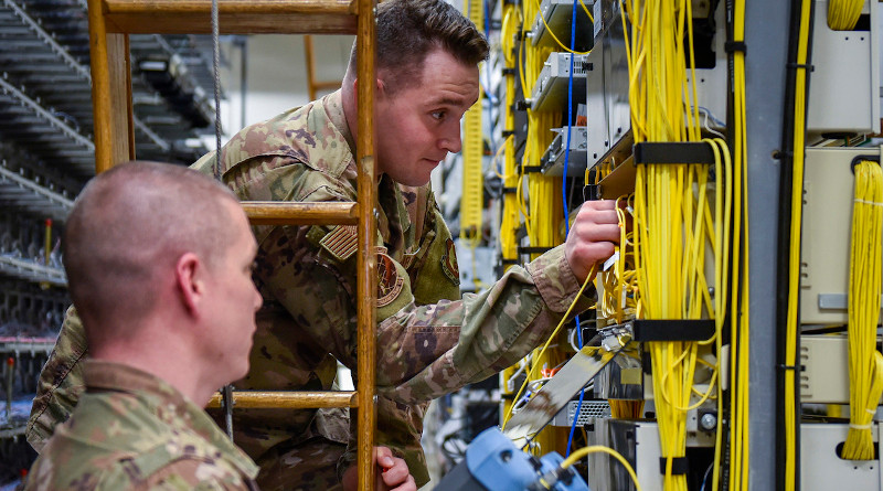 Airmen troubleshoot the fiber optic distribution panels, Feb. 11, 2020, at Eglin Air Force Base, Fla. The fiber optic distribution panels are a part of the critical network infrastructure on base. Photo Credit: Air Force 2nd Lt. Christine Saunders