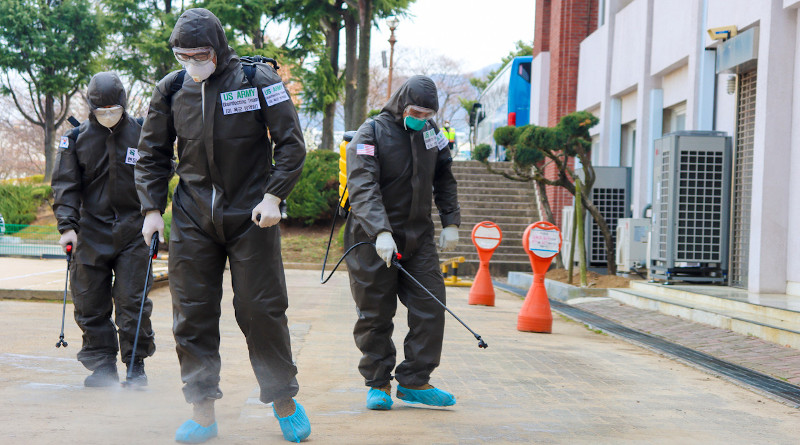 spray a COVID-19 infected area with a solution of disinfectant in Daegu, South Korea, March 13, 2020. Photo Credit: Army Spc. Hayden Hallman