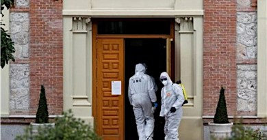 Workers disinfecting a building in fight against coronavirus in Spain. Photo Credit: Tasnim News Agency