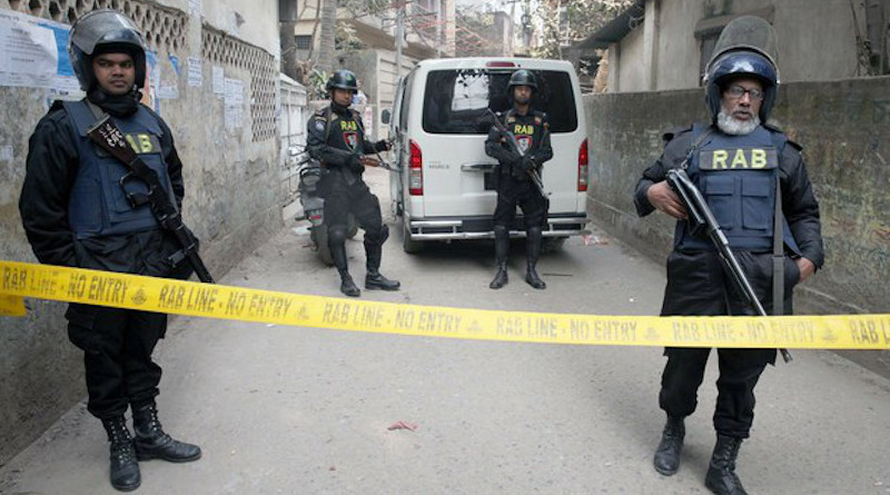 File photo of members of Bangladesh's Rapid Action Battalion cordon off a suspected militant hideout in Dhaka. BenarNews