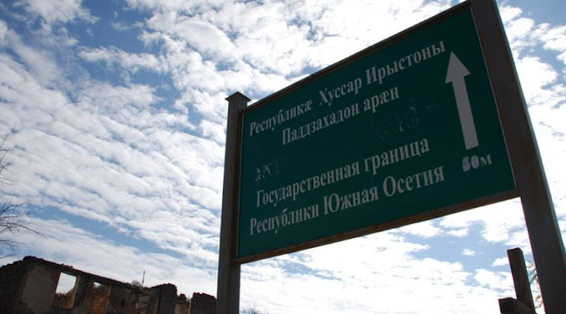"In Dvani the sign in Russian and Ossetian alerts the dividing line; it reads: ""The State Border of the Republic of South Ossetia"". Photo: Monica Ellena / Civil.ge archive"