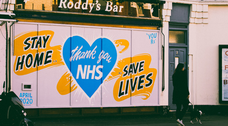 A woman walks past a street mural, during the lockdown in London 2020. Photo Credit: Edward Howell at Unsplash