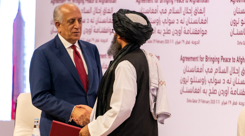 US Special Representative for Afghanistan Reconciliation Zalmay Khalilzad and Taliban co-founder Mullah Abdul Ghani Baradar shake hands after signing a landmark peace agreement in ceremony at Qatari capital Doha on February 29, 2020. Photo Credit: State Department photo by Ron Przysucha/ Public Domain