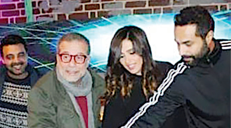 Sherif Mounir and Yasmine, center, were set to work in a series that has been postponed. (Social media)