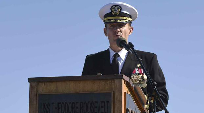 File Photo: Capt. Brett Crozier addresses the crew for the first time as commanding officer of the aircraft carrier USS Theodore Roosevelt (CVN 71) during a change of command ceremony. (U.S. Navy/Mass Communication Specialist 3rd Class Sean Lynch)