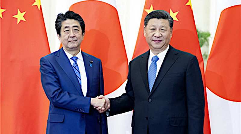 China's President Xi Jinping meets with Prime Minister Shinzo Abe of Japan. Photo Credit: Ministry of Foreign Affairs of the People's Republic of China