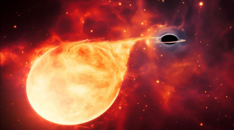 This artist's impression depicts a star being torn apart by an intermediate-mass black hole (IMBH), surrounded by an accretion disc. This thin, rotating disc of material consists of the leftovers of a star which was ripped apart by the tidal forces of the black hole. CREDIT ESA/Hubble, M. Kornmesser