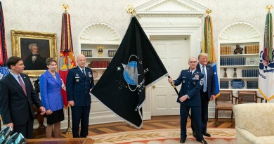 US Space Force CSO GEN Jay Raymond and US Space Force Senior Enlisted Advisor CMSgt Roger Towberman present President Donald J. Trump with the U.S. Space Force Flag Thursday, May 15, 2020, in the Oval Office of the White House. (Official White House Photo by Shealah Craighead)