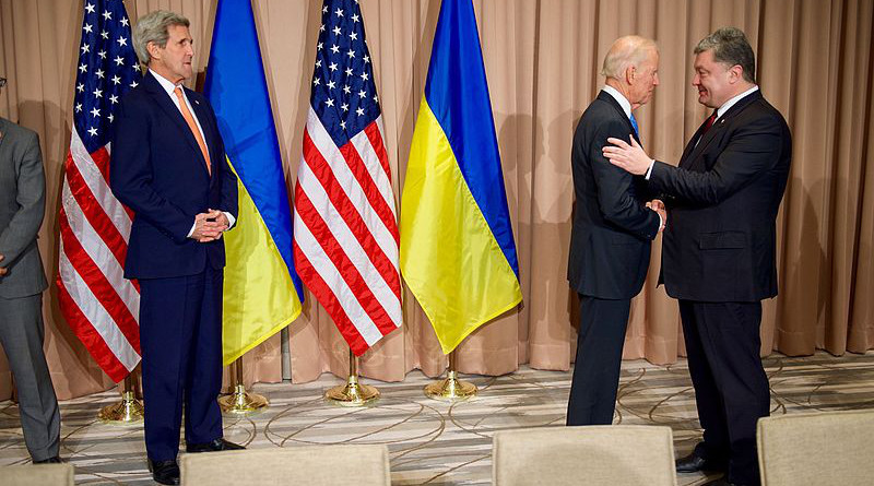 U.S. Secretary of State John Kerry looks as Vice President Joe Biden shakes hands with Ukrainian President Petro Poroshenko on January 20, 2016, at the Intercontinental Hotel in Davos, Switzerland, before a bilateral meeting on the sidelines of the World Economic Forum. [State Department photo/ Public Domain]